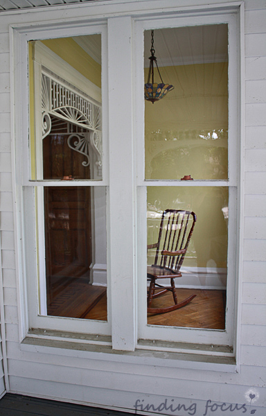 rocking chair through the window photo