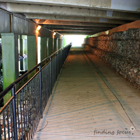 Tunnel walkway - sidewalk path under the road