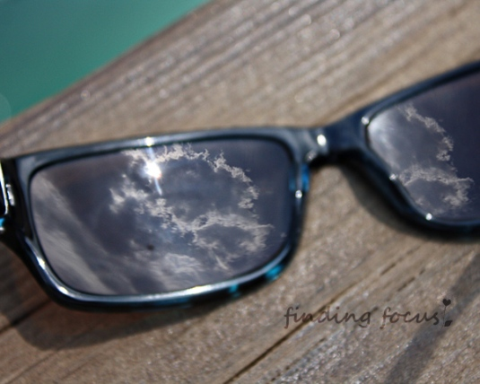 sunshine reflected in sunglasses, sun reflected in sunglasses, reflections in sunglasses