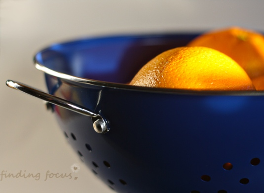 oranges in blue colander kitchen photography