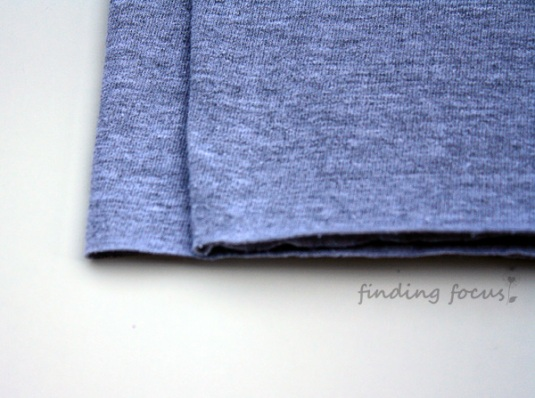 folded gray tshirt, folded gray t-shirt, folded grey tshirt, folded grey t-shirt, folding a t-shirt to create yarn